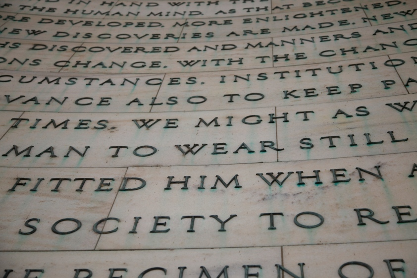 Photo of the panel at the Jefferson Memorial that says laws and systems must change.